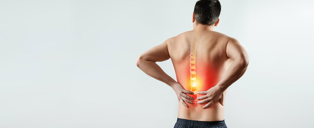 man holding lower pain with pain