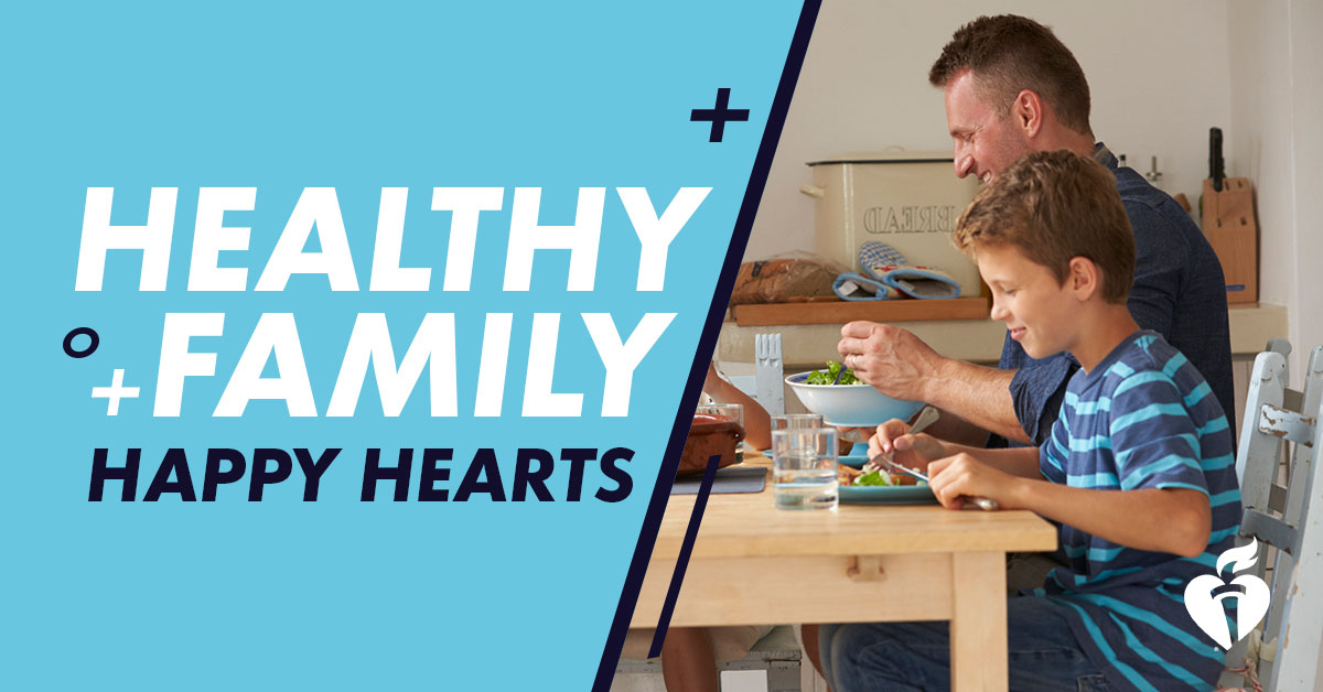 Healthy Family Happy Hearts - dad and young son eating together