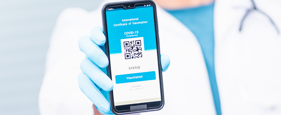 doctor holding phone with qr code
