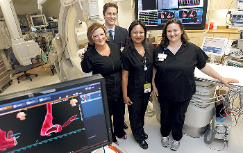 Dr. George Carayannopoulos, director of the UTMB's Heart Rhythm Center, and registered nurses Sheila Saunders, from left, Luisa Anderson and Nikki Williams