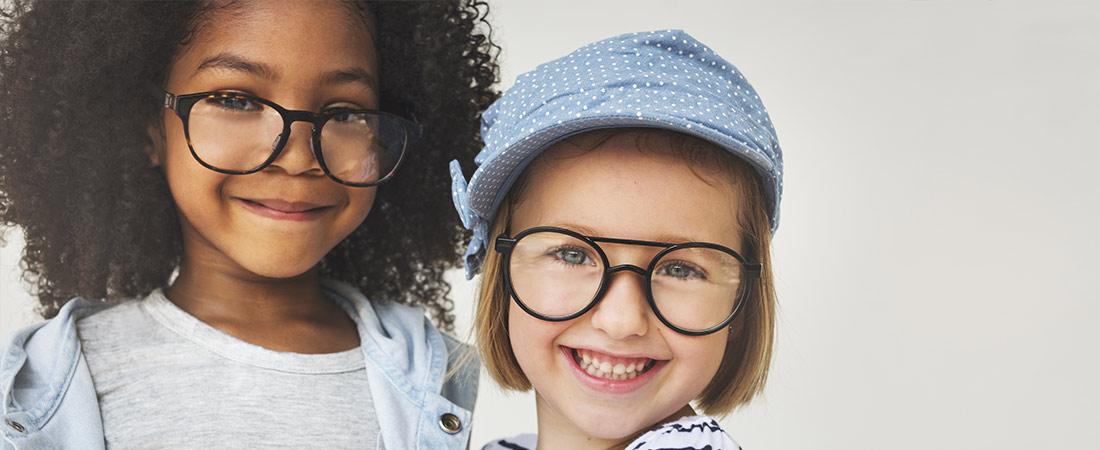 two children wearing glasses
