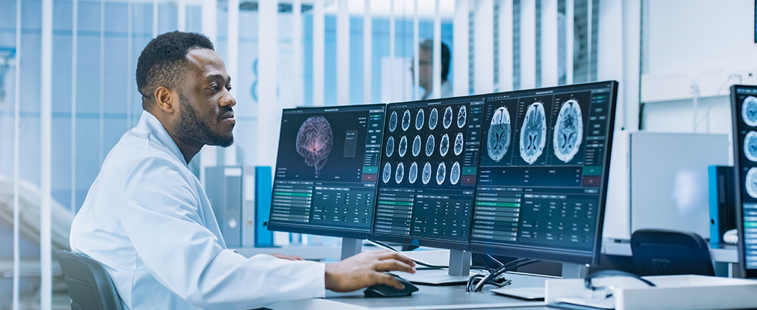 doctor studying brain scans